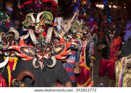 Píllaro, ECUADOR - FEBRUARY 6, 2016: Unknown locals dressed up participating in the Diablada, popular town celebrations with people dressed as devils dancing in the streets - stock photo