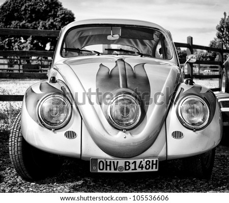 """PAAREN IM GLIEN, GERMANY - MAY 26: Cars Volkswagen Beetle (black and white), """"The oldtimer show"""" in MAFZ, May 26, 2012 in Paaren im Glien, Germany - stock photo"""