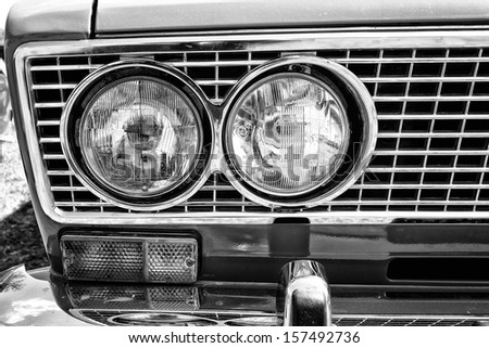 "PAAREN IM GLIEN, GERMANY - MAY 19: Headlamp soviet family car VAZ-2106, close-up, black and white, ""The oldtimer show"" in MAFZ, May 19, 2013 in Paaren im Glien, Germany - stock photo"