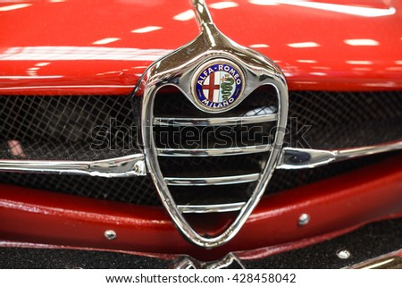 "PAAREN IM GLIEN, GERMANY - MAY 15: vintage logo Alfa Romeo at a red classic car, ""The oldtimer show"" in MAFZ, May 15, 2016 in Paaren im Glien, Germany - stock photo"