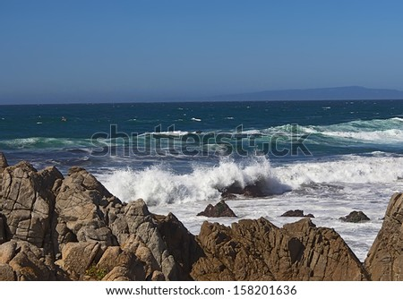 Pacific coast with rocks and waves near Monterey, California - stock photo