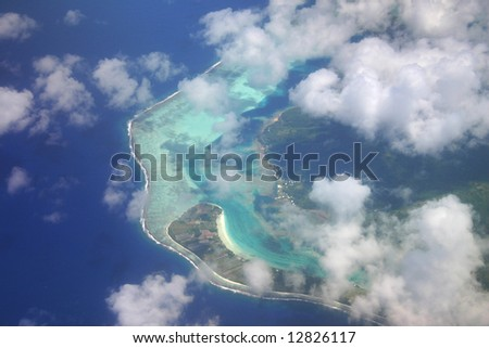 Pacific Islands hidden by the clouds. Aerial view. French Polynesia - stock photo