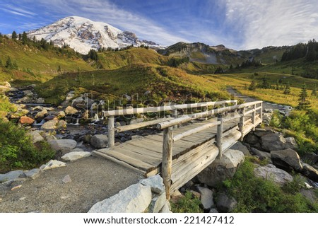 Pacific northwest with Mt. Rainier in the distance and a bridge in the foreground - stock photo