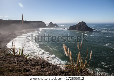 Pacific Ocean waves wash ashore along the rugged northern California coastline in Elk, a small town near Mendocino. Highway 1 runs right along the coast and provides gorgeous views of the shore. - stock photo