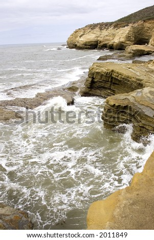 Pacific surf on rocks - stock photo