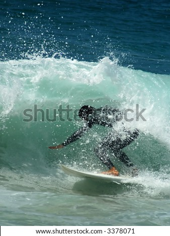 Pacific Surfer Finds a Tube - stock photo