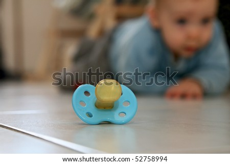 pacifier and baby - stock photo