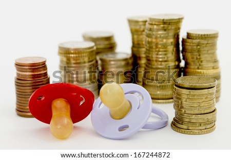 pacifier with hard money  in light background.
