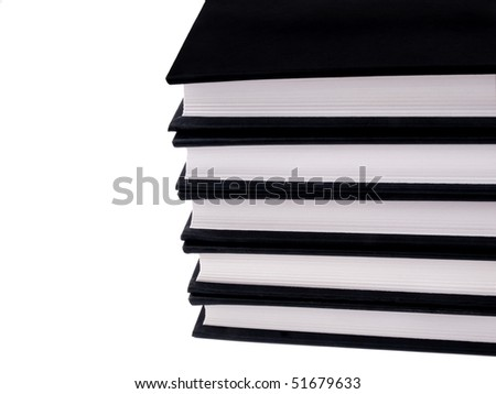 Pack of books in black covers on white background