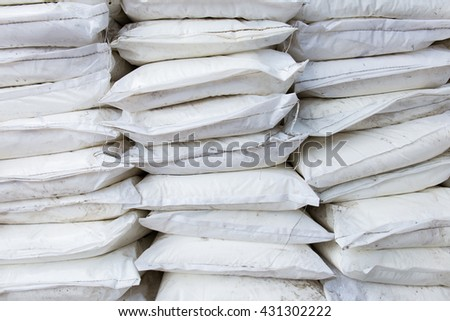Pack of chemical sacks in warehouse store - stock photo