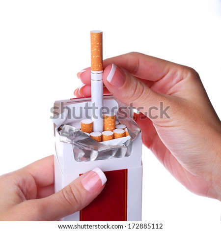 Pack of Cigarettes in Female Hands isolated on white background - stock photo