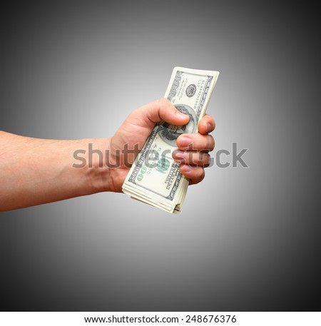 pack of dollars in a fist - stock photo