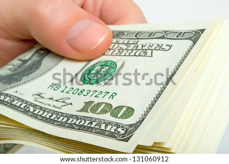 Pack of dollars in a man's hand. - stock photo