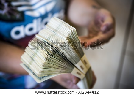 pack of money - big pile of banknotes in hand, czech crown - stock photo