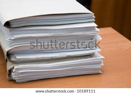 Pack of paper documents on a desk - stock photo
