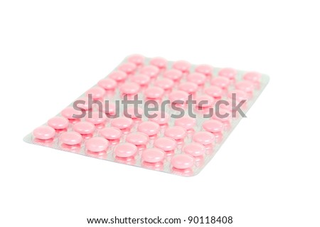 pack of pink tablets on a white background