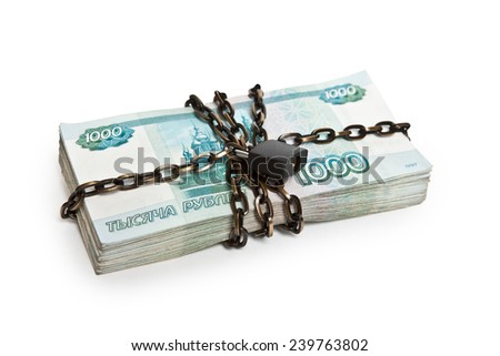 Pack of Russian paper bills in the circuit under lock and key - stock photo
