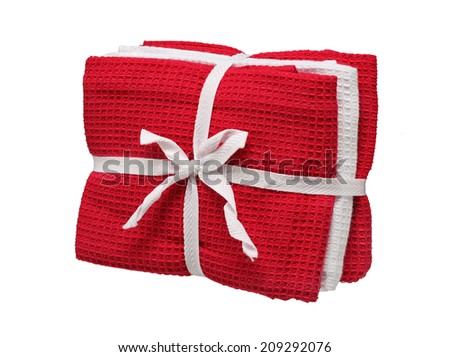 Pack of three kitchen towels made from cotton (red and white). Studio photography of towels with a bow - isolated on white background  - stock photo