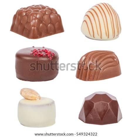 Pack, set or collection of gourmet bonbons, aka bon-bons and truffles made of dark, white and milk chocolate isolated on white background