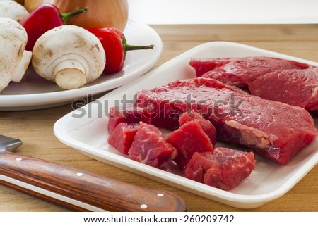 Package of raw beef steaks ready for cooking - stock photo