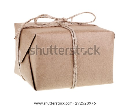 Package wrapped in brown paper and string on a white background - stock photo