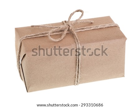 Package wrapped in brown paper and twine on a white background - stock photo