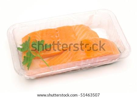 packaged fresh salmon on white background - stock photo