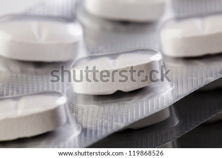 Packaged Pills in aluminium blisters stacked on each other
