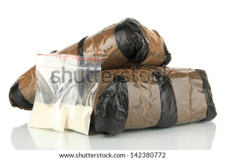 Packages of  narcotics isolated on white - stock photo