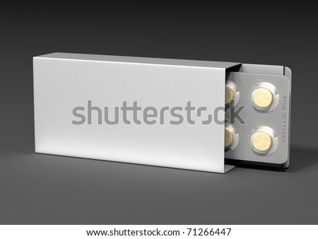 Packaging and yellow pill with a gray background - stock photo