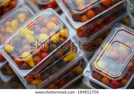 packaging fresh tomatoes  - stock photo