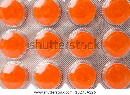 Packaging of orange pills isolated on white background - stock photo