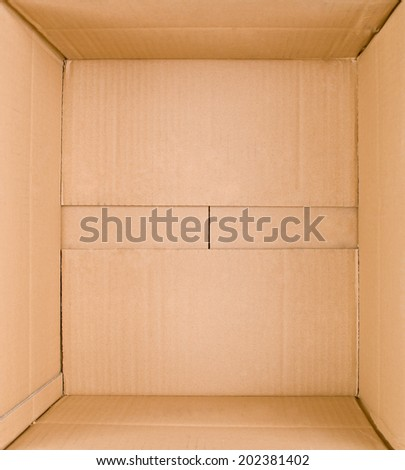 Packed or hidden inside a cardboard packaging box - stock photo