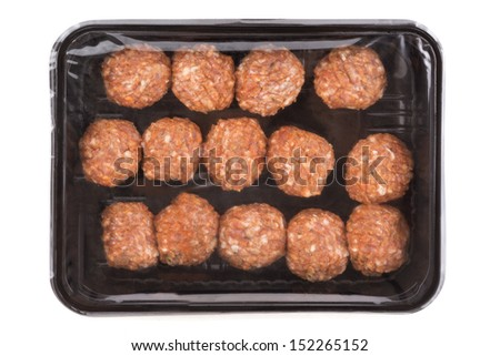 Packed raw meat balls in black tray. isolated on white background.