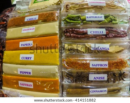 Packed spices and herbs at the market - stock photo