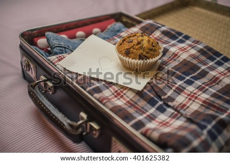packed vintage suitcase with a surprise- muffin and a love letter note