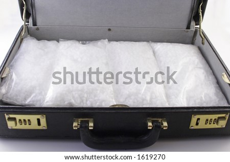 packets of crack cocaine in a briefcase
