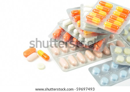 Packs of different pills - abstract medical background - stock photo