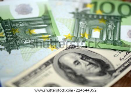 packs of dollars and euro money - stock photo