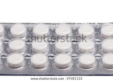 packs of vitamins on the white isolated background