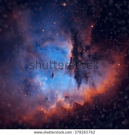 Pacman Nebula (NGC 281) is an H II region in the constellation of Cassiopeia and part of the Perseus Spiral Arm. Retouched image with small DOF. Elements of this image furnished by NASA. - stock photo