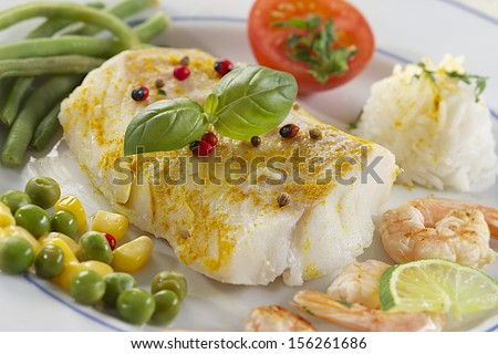pad cod cod fillet, cooking steam, cod fillet with curry - stock photo
