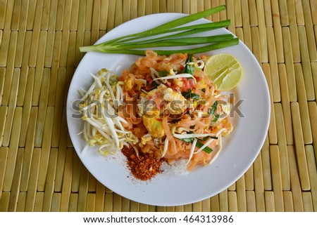 Pad Thai stir fried rice noodle with egg and vegetable on dish