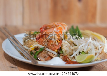 Pad Thai , vermicelli and fresh shrimp fried and stir with Thai style.Selective focus. Very shallow Depth of Field, for soft background.