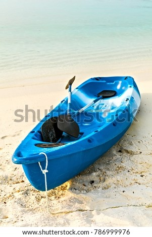 Paddle blue boat is on sandy beach, Maldives
