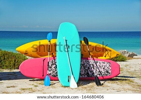 Paddle Boarding and Kayak Rentals on the Beach   - stock photo