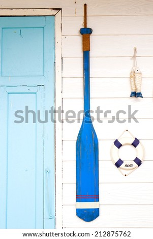 Paddle boats made of wood on wall. - stock photo
