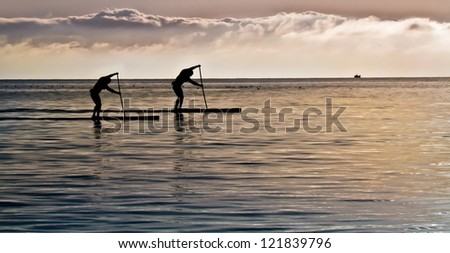 Paddle Surfing on the Ocean - Photographed at Whiterock Beach in Whiterock, British Columbia, Canada.