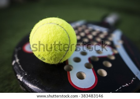 Paddle tennis macro wide angle image of racket and ball