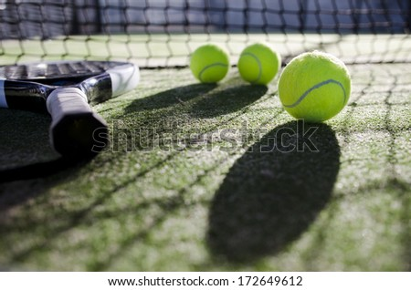 paddle tennis objects ion artificial turf ready for tournament with hard dramatic shadows. - stock photo